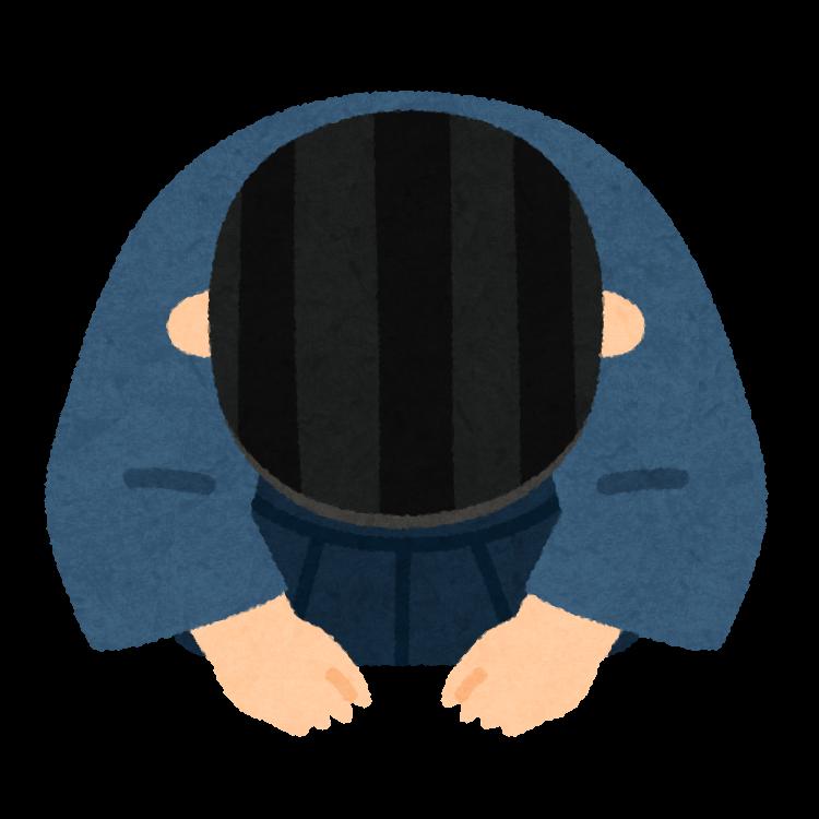 頭を下げる男性